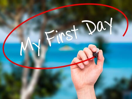 first day: Man Hand writing My First Day with black marker on visual screen. Isolated on nature. Business, technology, internet concept. Stock Photo