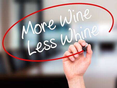 whine: Man Hand writing More Wine Less Whine with black marker on visual screen. Isolated on office. Business, technology, internet concept. Stock Photo Stock Photo