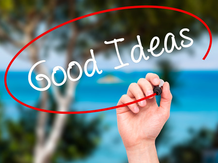 think out of the box: Man Hand writing Good Ideas with black marker on visual screen. Isolated on background. Business, technology, internet concept. Stock Photo Stock Photo