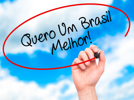 protestors: Man Hand writing Quero Um Brasil Melhor!  ( I want a Better Brazil in Portuguese)with black marker on visual screen. Isolated on sky. Business, technology, internet concept. Stock Photo