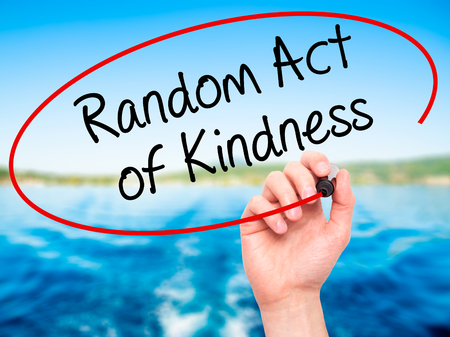 helpfulness: Man Hand writing Random Act of Kindness with black marker on visual screen. Isolated on nature. Business, technology, internet concept. Stock Photo