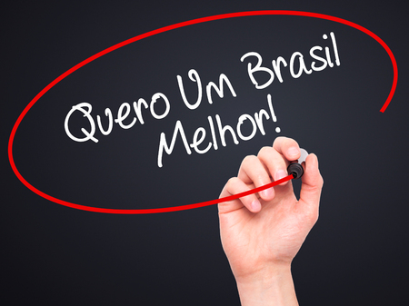 protestors: Man Hand writing Quero Um Brasil Melhor!  ( I want a Better Brazil in Portuguese)with black marker on visual screen. Isolated on black. Business, technology, internet concept. Stock Photo Stock Photo