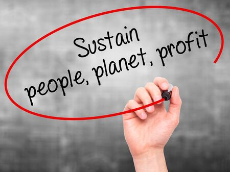 sustain: Man Hand writing Sustain, people, planet, profit with black marker on visual screen. Isolated on grey. Business, technology, internet concept. Stock Photo