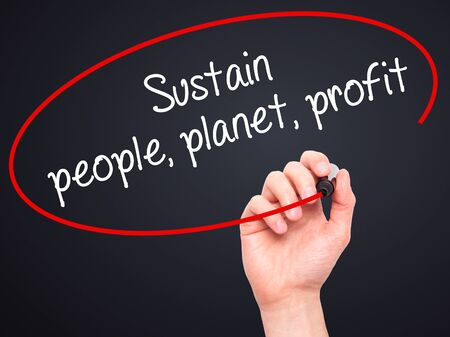 sustain: Man Hand writing Sustain, people, planet, profit with black marker on visual screen. Isolated on black. Business, technology, internet concept. Stock Photo Stock Photo