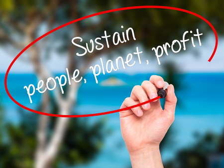 sustain: Man Hand writing Sustain, people, planet, profit with black marker on visual screen. Isolated on nature. Business, technology, internet concept. Stock Photo
