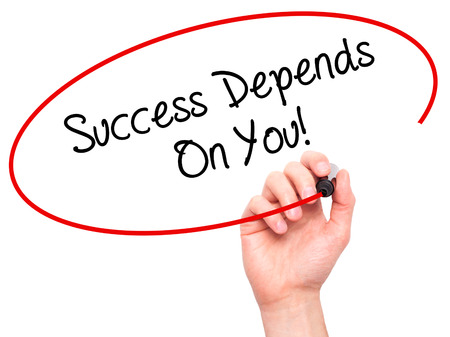 depend: Man Hand writing Success Depends On You! with black marker on visual screen. Isolated on white. Business, technology, internet concept. Stock Photo