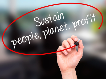 sustain: Man Hand writing Sustain, people, planet, profit with black marker on visual screen. Isolated on office. Business, technology, internet concept. Stock Photo