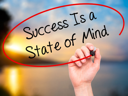 brain aging: Man Hand writing Success Is a State of Mind with black marker on visual screen. Isolated on nature. Business, technology, internet concept. Stock Photo
