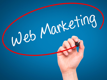 web marketing: Man Hand writing Web Marketing with black marker on visual screen. Isolated on blue. Business, technology, internet concept. Stock Photo