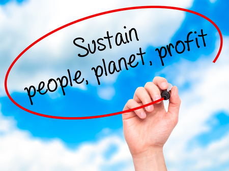 sustain: Man Hand writing Sustain, people, planet, profit with black marker on visual screen. Isolated on sky. Business, technology, internet concept. Stock Photo