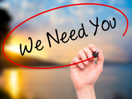 point of demand: Man Hand writing We Need You with black marker on visual screen. Isolated on nature. Business, technology, internet concept. Stock Photo Stock Photo