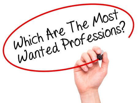 most talent: Man Hand writing Which Are The Most Wanted Professions? with black marker on visual screen. Isolated on background. Business, technology, internet concept. Stock Photo