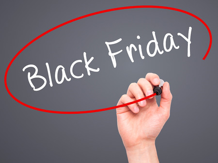 writing black: Man Hand writing Black Friday with black marker on visual screen. Isolated on grey. Business, technology, internet concept. Stock Image Stock Photo