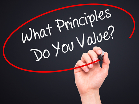 principles: Man Hand writing What Principles Do You Value? with black marker on visual screen. Isolated on black. Business, technology, internet concept. Stock Photo Stock Photo