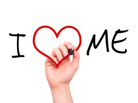 Man hand writing I Love Me on visual screen. Love, family, internet concept. Isolated on white. Stock Photo