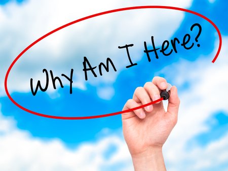 i am here: Man Hand writing Why Am I Here? with black marker on visual screen. Isolated on sky. Business, technology, internet concept. Stock Photo