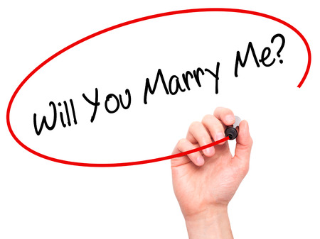 will you marry me: Man Hand writing Will You Marry Me? with black marker on visual screen. Isolated on background. Business, technology, internet concept. Stock Photo