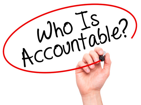 obligate: Man Hand writing Who Is Accountable? with black marker on visual screen. Isolated on white. Business, technology, internet concept. Stock Image Stock Photo