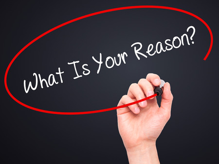 aim: Man Hand writing What Is Your Reason? with black marker on visual screen. Isolated on background. Business, technology, internet concept. Stock Photo Stock Photo