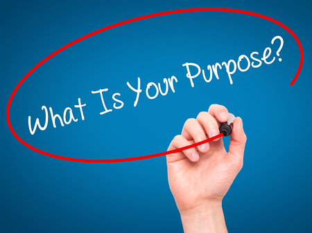 Man Hand writing What Is Your Purpose?  with black marker on visual screen. Isolated on background. Business, technology, internet concept. Stock Photo Archivio Fotografico