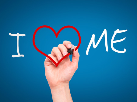 egoistic: Man hand writing I Love Me on visual screen. Love, family, internet concept. Isolated on blue. Stock Photo
