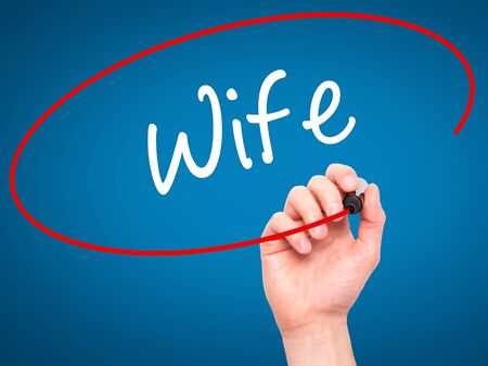 ex husband: Man Hand writing Wife with black marker on visual screen. Isolated on background. Business, technology, internet concept. Stock Photo