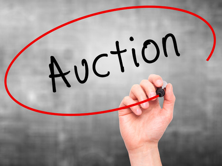 vend: Man Hand writing Auction with black marker on visual screen. Isolated on grey. Business, technology, internet concept. Stock Image