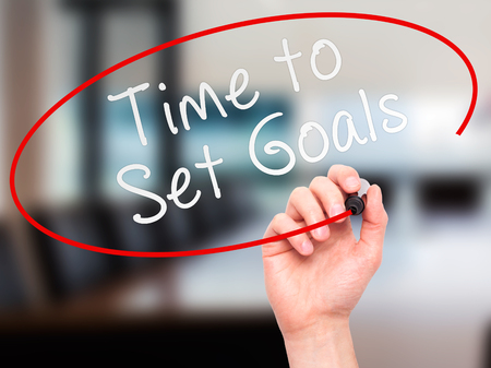 business help: Man hand writing Time to Set Goals on visual screen. Business,help, internet, technology concept. Isolated on office. Stock Photo Stock Photo