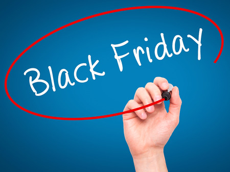 writing black: Man Hand writing Black Friday with black marker on visual screen. Isolated on blue. Business, technology, internet concept. Stock Image Stock Photo