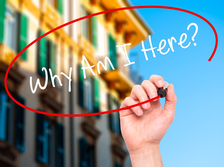 i am here: Man Hand writing Why Am I Here? with black marker on visual screen. Isolated on city. Business, technology, internet concept. Stock Photo Stock Photo