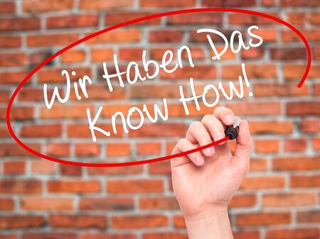 knowhow: Man Hand writing Wir Haben Das Know How! (We Have the Know-How in German)  with black marker on visual screen. Isolated on background. Business, technology, internet concept. Stock Photo