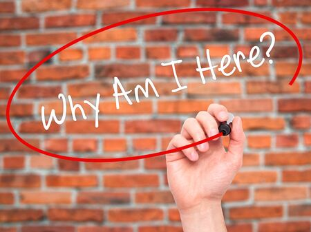 i am here: Man Hand writing Why Am I Here? with black marker on visual screen. Isolated on bricks. Business, technology, internet concept. Stock Photo Stock Photo