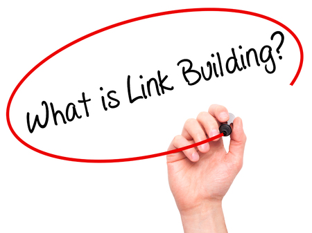 keywords link: Man Hand writing What is Link Building? with black marker on visual screen. Isolated on white. Business, technology, internet concept. Stock Photo Stock Photo