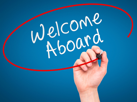 aboard: Man hand writing Welcome Aboard on visual screen. Business,help, internet, technology concept. Isolated on blue. Stock Photo Stock Photo