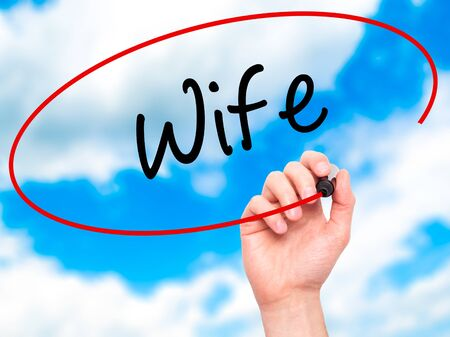 ex wife: Man Hand writing Wife with black marker on visual screen. Isolated on background. Business, technology, internet concept. Stock Photo