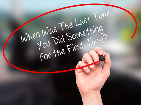 promptness: Man Hand writing When Was The Last Time You Did Something for the First Time? with black marker on visual screen. Isolated on office. Business, technology, internet concept. Stock Photo Stock Photo