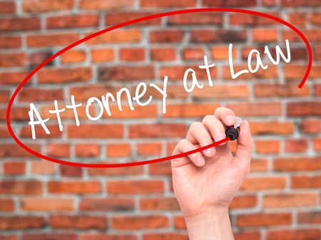 rightfulness: Man Hand writing Attorney at Law with black marker on visual screen. Isolated on background. Business, technology, internet concept. Stock Photo