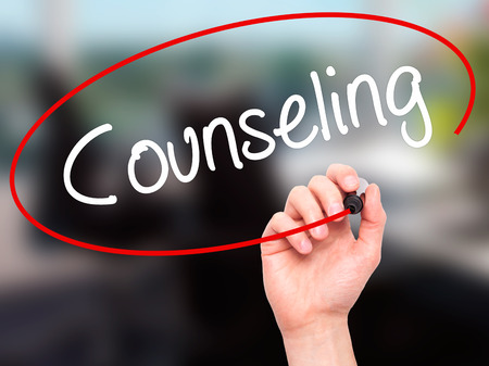 Man Hand writing Counseling with black marker on visual screen. Isolated on background. Business, technology, internet concept. Stock Photo Imagens - 53030120