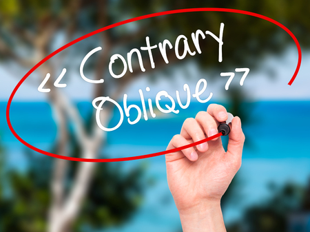 contrary: Man Hand writing Contrary - Oblique with black marker on visual screen. Isolated on background. Business, technology, internet concept. Stock Photo