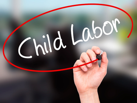 slave labor: Man Hand writing Child Labor with black marker on visual screen. Isolated on background. Business, technology, internet concept. Stock Photo