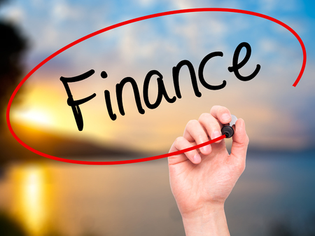 interst: Man Hand writing Finance with black marker on visual screen. Isolated on background. Business, technology, internet concept. Stock Photo Stock Photo