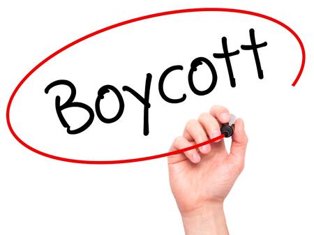 boycott: Man Hand writing Boycott with black marker on visual screen. Isolated on background. Business, technology, internet concept. Stock Photo Stock Photo