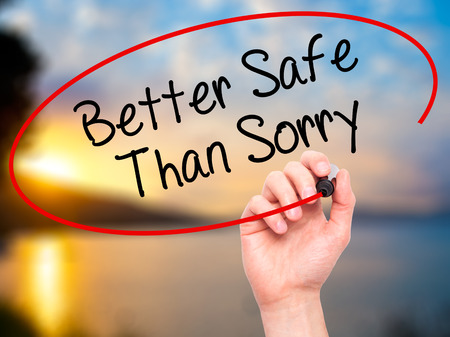 better chances: Man Hand writing Better Safe Than Sorry with black marker on visual screen. Isolated on background. Business, technology, internet concept. Stock Photo