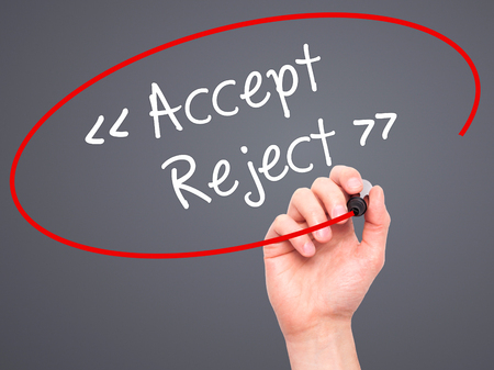 approvement: Man Hand writing Accept - Reject  with black marker on visual screen. Isolated on background. Business, technology, internet concept. Stock Photo Stock Photo