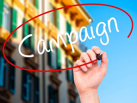 strategic focus: Man Hand writing Campaign with black marker on visual screen. Isolated on background. Business, technology, internet concept. Stock Photo