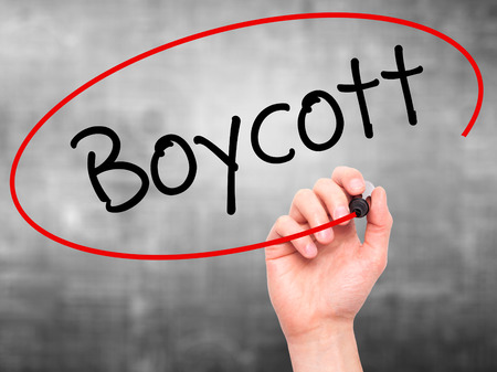denying: Man Hand writing Boycott with black marker on visual screen. Isolated on background. Business, technology, internet concept. Stock Photo Stock Photo