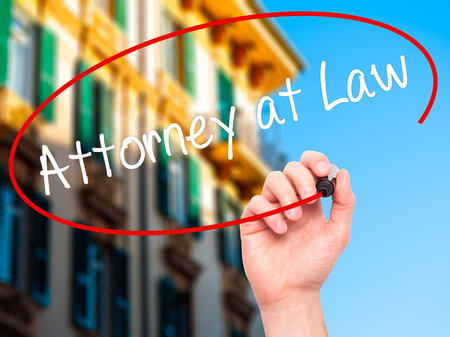 lawfulness: Man Hand writing Attorney at Law with black marker on visual screen. Isolated on background. Business, technology, internet concept. Stock Photo