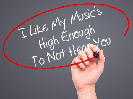enough: Man Hand writing I Like My Musics High Enough To Not Hear You with black marker on visual screen. Isolated on background. Business, technology, internet concept. Stock Photo