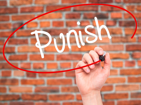 enforcing: Man Hand writing Punish with black marker on visual screen. Isolated on background. Business, technology, internet concept. Stock Photo