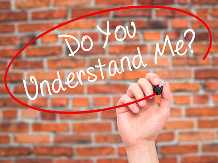understand: Man Hand writing Do You Understand Me? with black marker on visual screen. Isolated on background. Business, technology, internet concept. Stock Photo Stock Photo